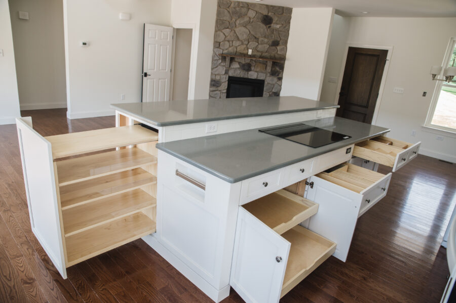 The kitchen island with a multitude of storage and hidden pull-out doors