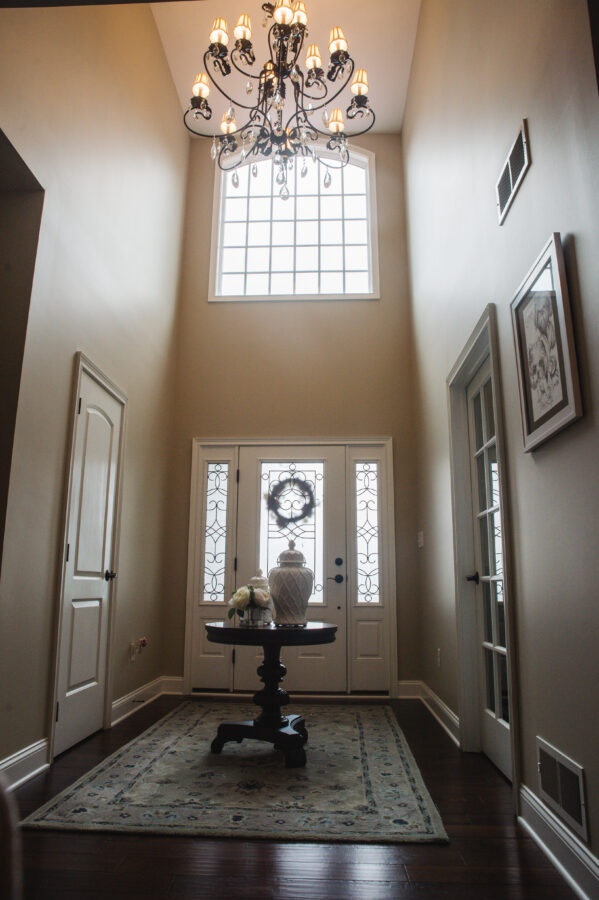 The two story open foyer with the home office off of the foyer with a 15-lite french door.
