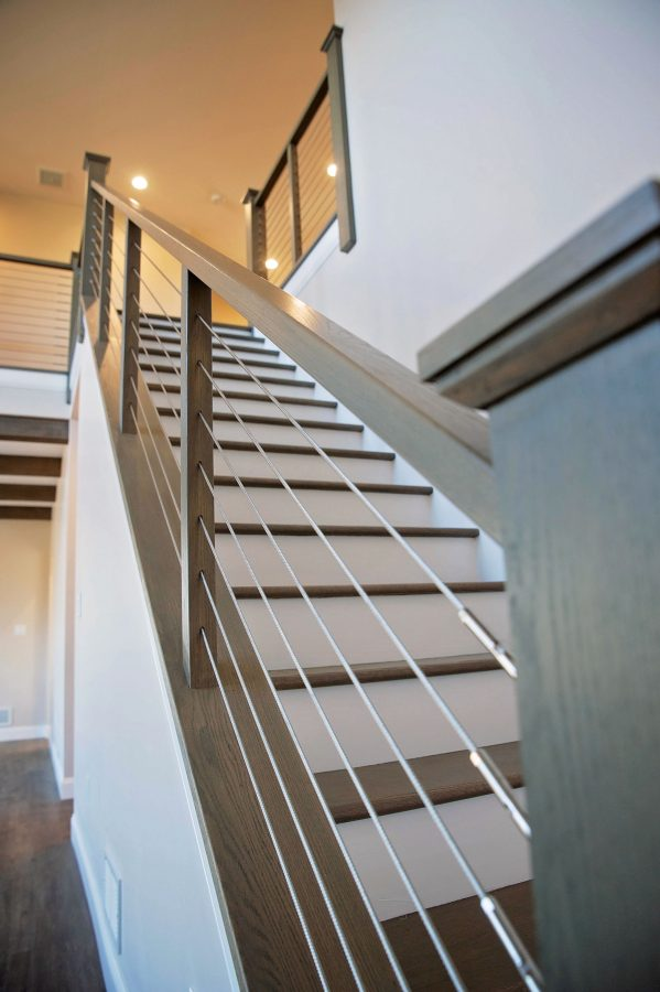 Oak Stained treads with painted risers with cable infill railing and craftsman newel post & railing