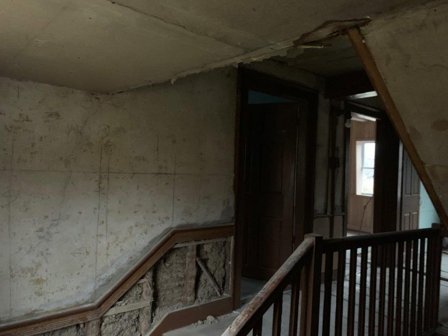 The stairwell and the hallway leading to the second floor before the custom remodel by Corrado Custom Homes.