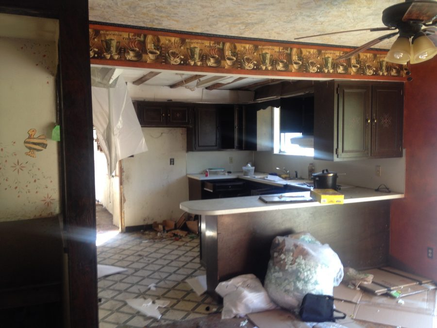 Photo of the dark and outdatted kitchen before renovation were started.