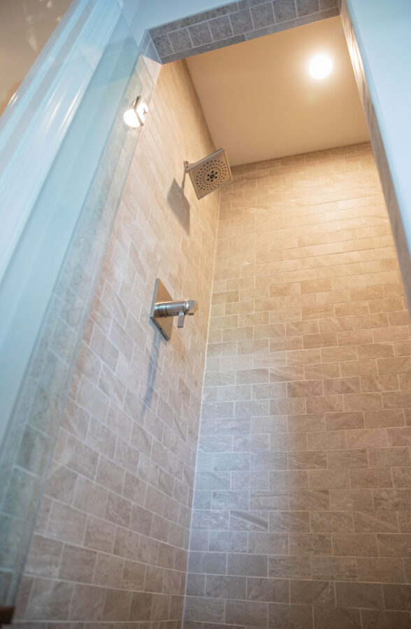 The Master Bathroom's tiled walk-in shower with a silver faucet and square shower head.