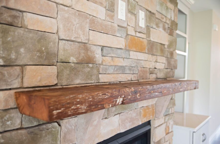 Close-up view of the repurposed barn-beam mantel that Corrado Custom Homes can supply for customers.