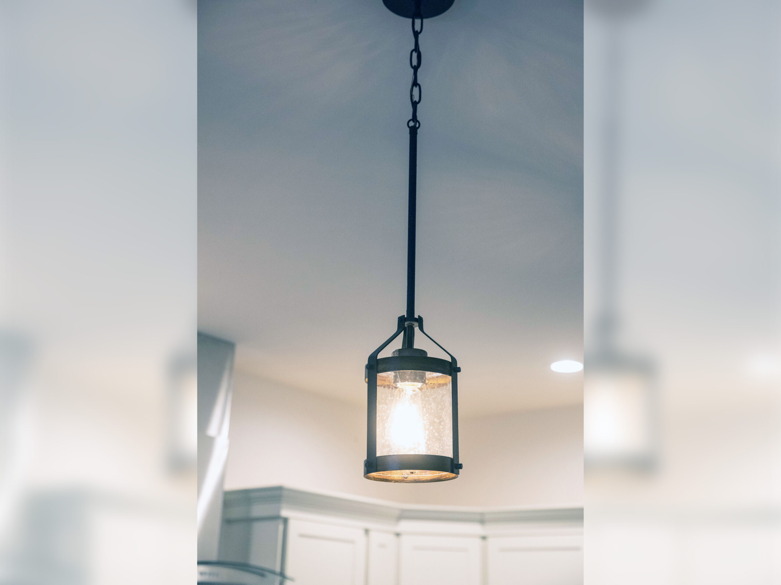 Wrought iron lighting fixture with a single lightbulb