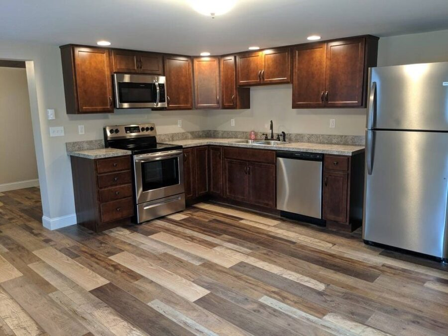 The fully remodeled Kitchen featuring Stained Kemper cabinetry.