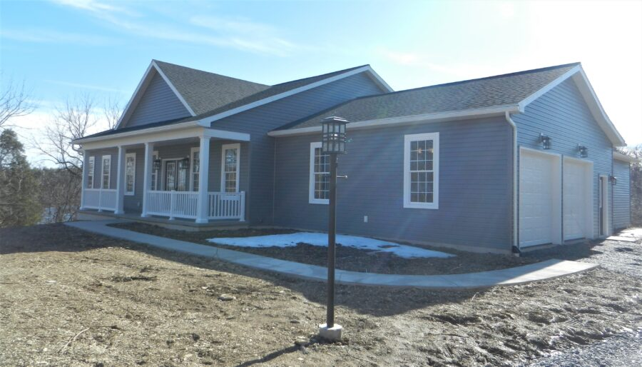 The front of a custom built home in the Lehigh Valley with charcoal grey siding.