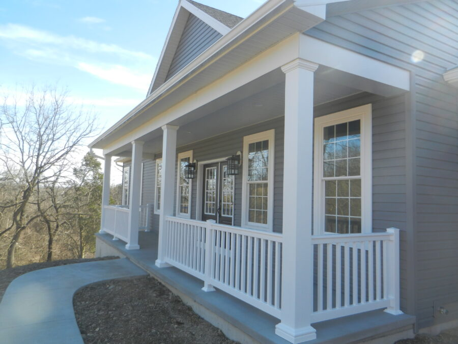 Full front porch with square columns and vinyl railing on a custom built home in the Lehigh Valley