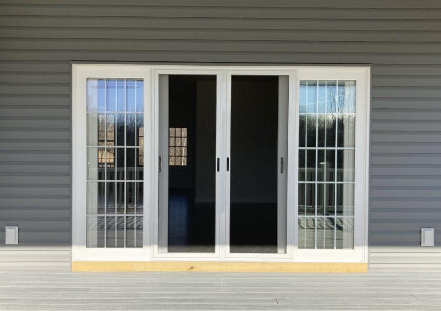 4-lite patio slider door with sliding screen door on the covered rear deck of a custom built home.