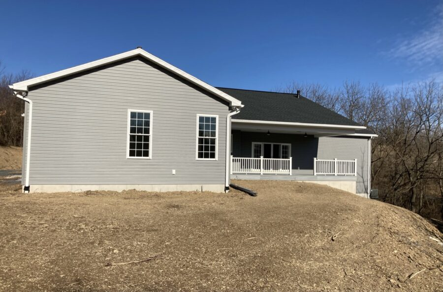 The back of a custom built home in the Lehigh Valley with a covered rear deck.