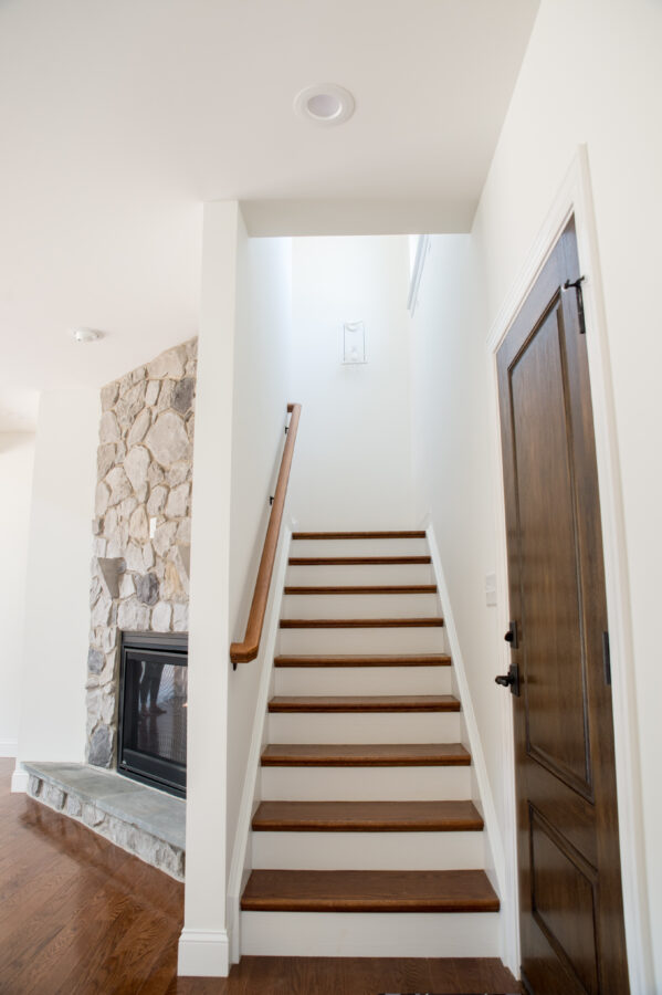 Oak treads and painted risers on the stairs leading to the second floor.