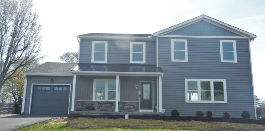 The front of a custom-built two-story home in Montgomery County featuring charcoal grey siding and white trim.
