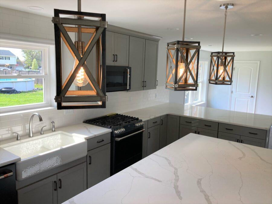 Three customer- supplied pendant lights above the kitchen island in the custom-designed kitchen island.