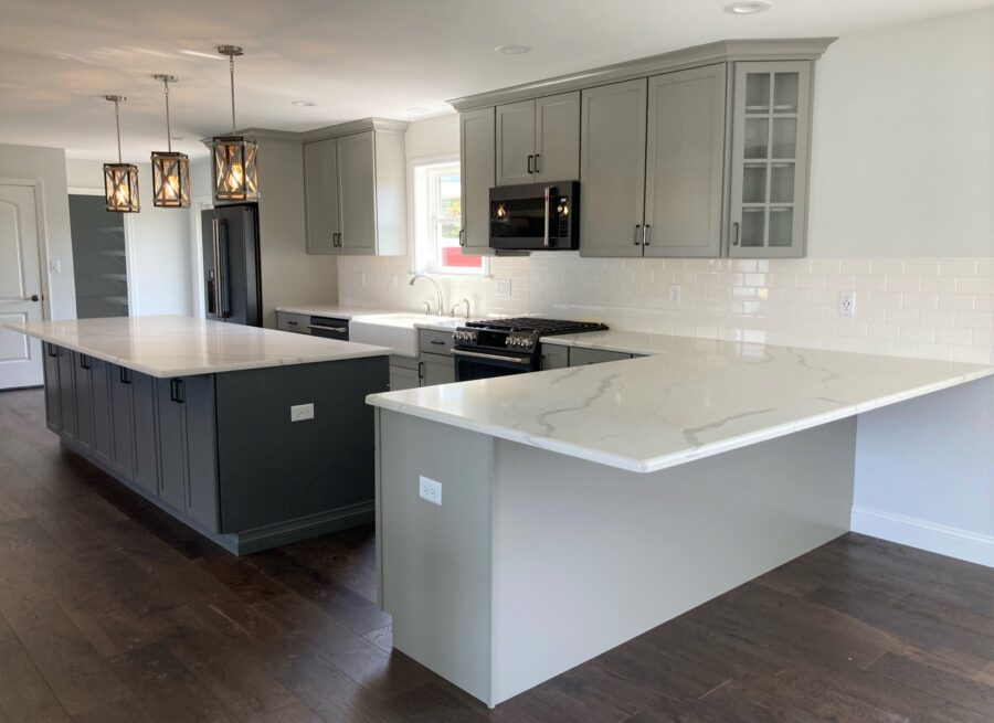 The custom-designed kitchen with amply counter space and an oversized kitchen island