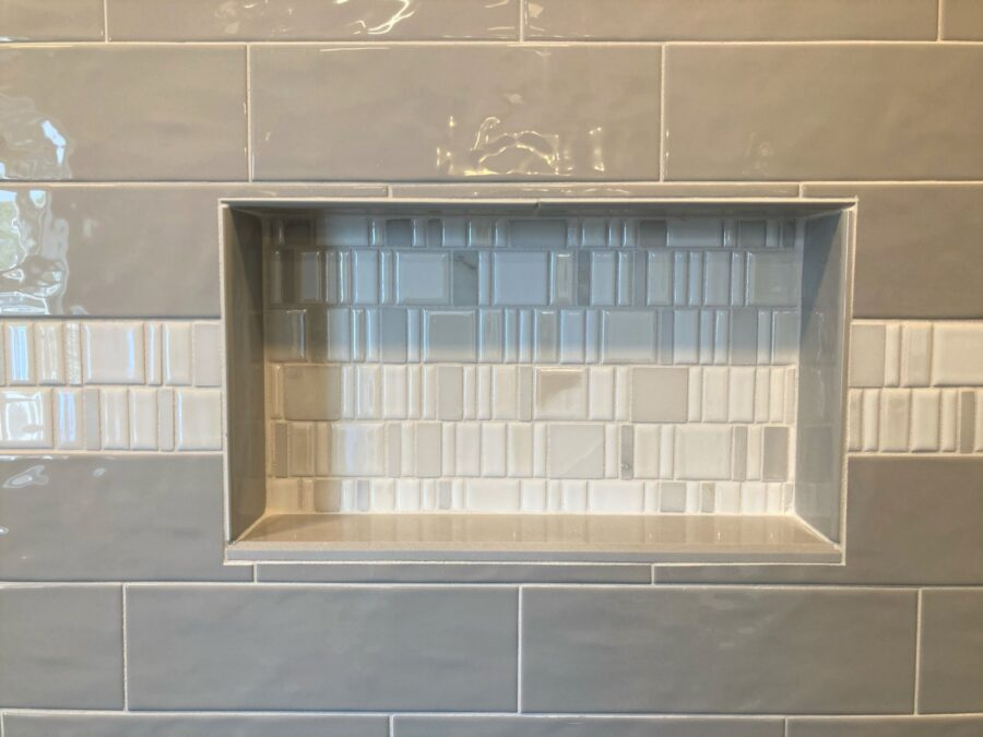 """The 12"""" x 20"""" tiled niche installed in the shower."""